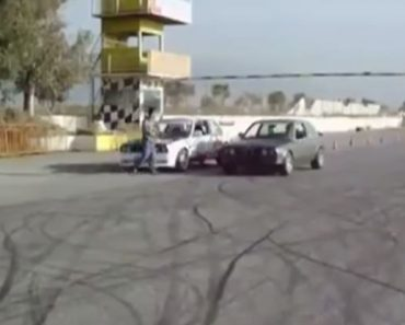 Two BMWs drifting